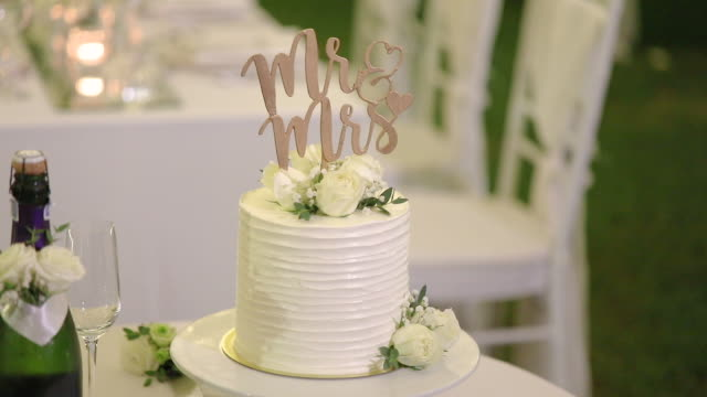 beautiful wedding cake decorated with flowers and white tone. - birthday cake stock videos & royalty-free footage