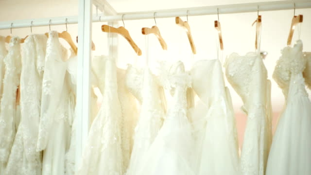 beautiful wedding dresses hanging on hangers. - wedding dress stock videos & royalty-free footage