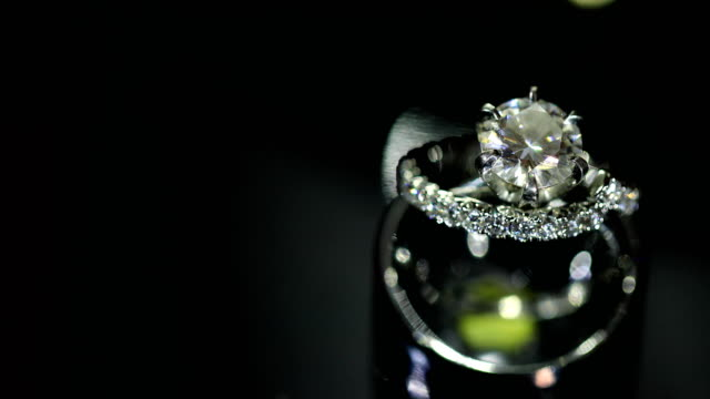 beautiful wedding ring and engagement ring, 4k. - married stock videos & royalty-free footage