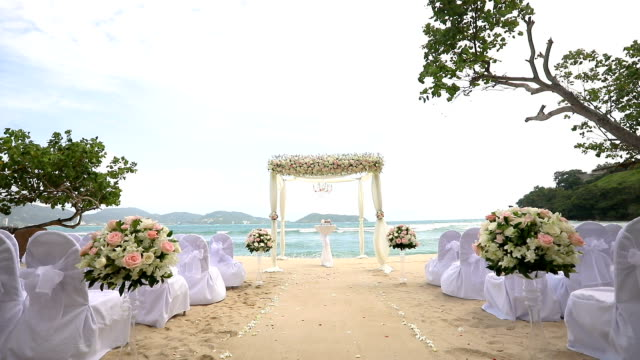 beautiful wedding set up over the sea. - wedding ceremony stock videos & royalty-free footage