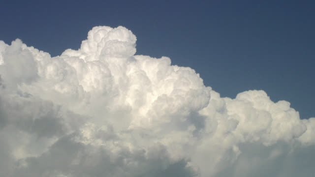 Beautiful white clouds bubbling up into a blue sky.