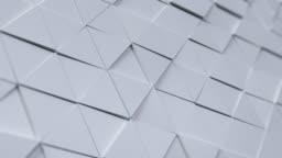 Beautiful White Triangles Morphing in Seamless 3d Animation. Abstract Motion Design Background.
