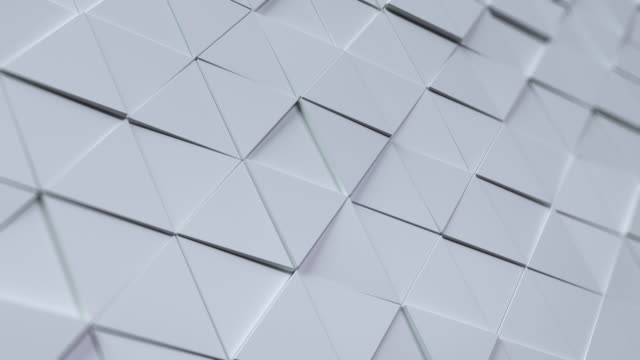 vídeos de stock e filmes b-roll de beautiful white triangles morphing in seamless 3d animation. abstract motion design background. - cinzento