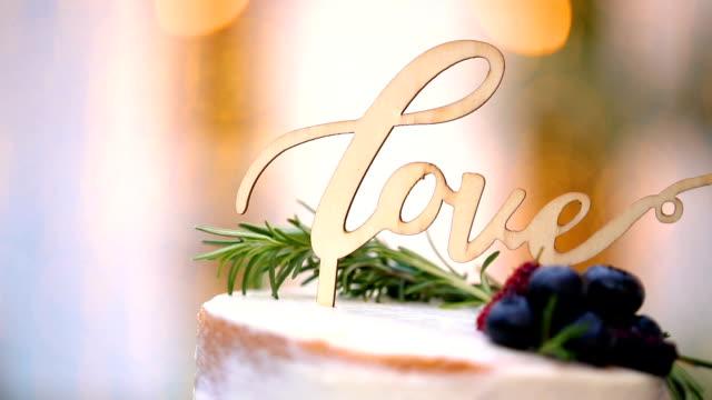 Beautiful white wedding cake at wedding reception.
