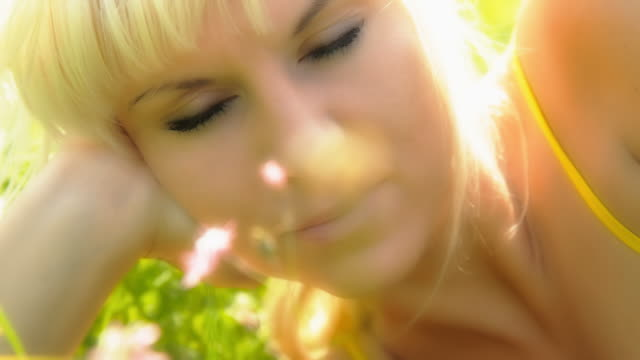 HD DOLLY: Beautiful Woman Among Meadow Flowers