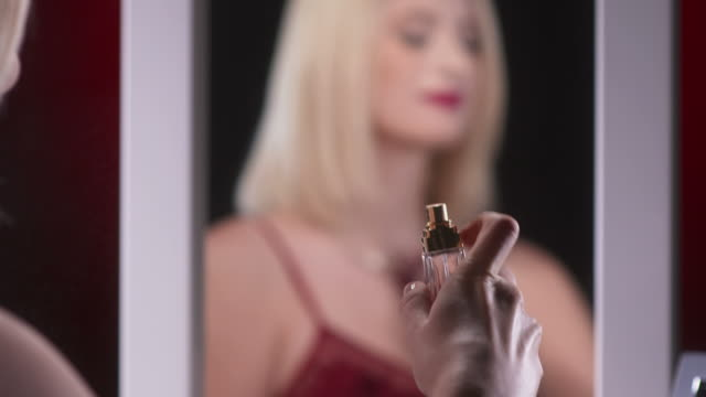 hd: beautiful woman applying fragrance - spraying stock videos and b-roll footage