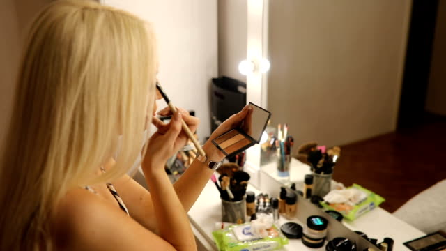 beautiful woman applying make up - stage make up stock videos and b-roll footage