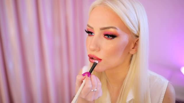 beautiful woman applying make-up on lips - blusher stock videos & royalty-free footage