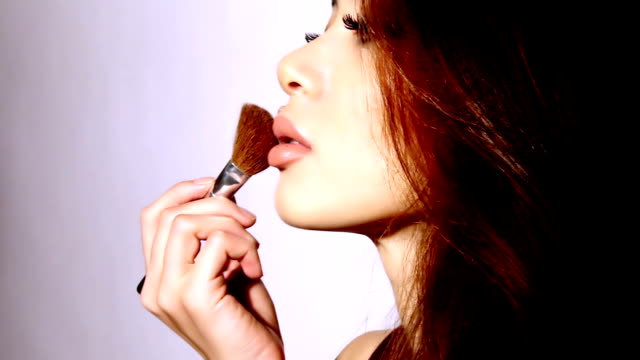 beautiful woman applyling blusher - stage make up stock videos and b-roll footage