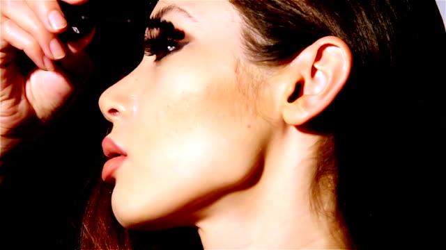 Beautiful woman applyling mascara v1