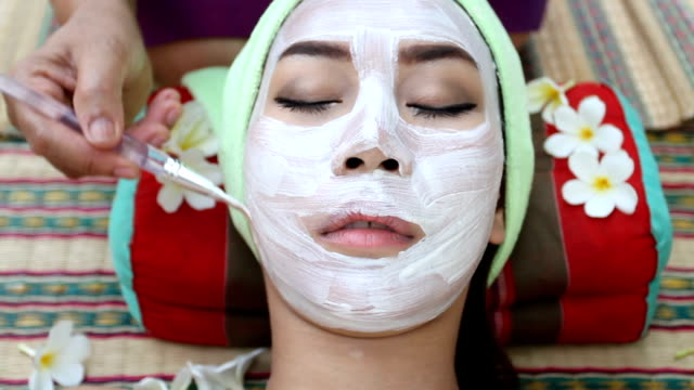 beautiful woman asia in spa and facial mask - clay stock videos & royalty-free footage