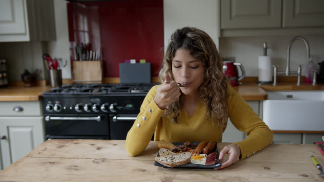 beautiful woman at home enjoying a delicious english breakfast - bean stock videos & royalty-free footage