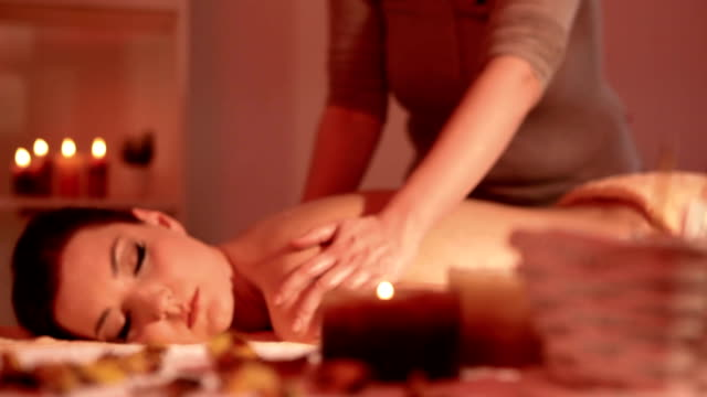 beautiful woman at massage therapy - acupuncture stock videos and b-roll footage