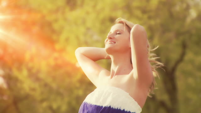 Beautiful woman basks in the sun