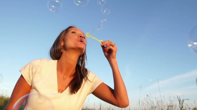 beautiful woman blows bubbles - bubble wand stock videos & royalty-free footage