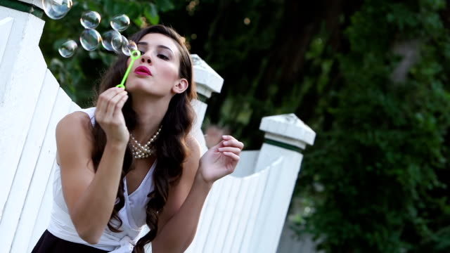 beautiful woman blows bubbles - brown hair stock videos & royalty-free footage