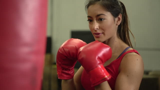 cu beautiful woman boxing in a gym - punch bag stock videos & royalty-free footage