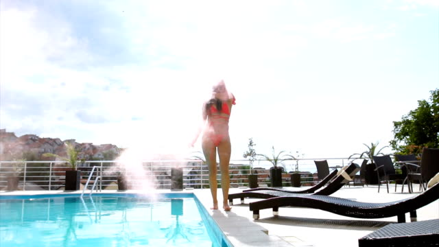 beautiful woman by the pool with flaming torch in her hand - swimwear stock videos and b-roll footage