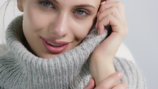 beautiful woman covering face in soft sweater - comfortable stock videos & royalty-free footage