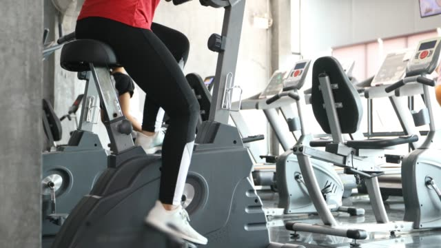 beautiful woman cycling on the exercise bike in the gym