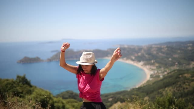 Beautiful woman dancing at the Corfu island