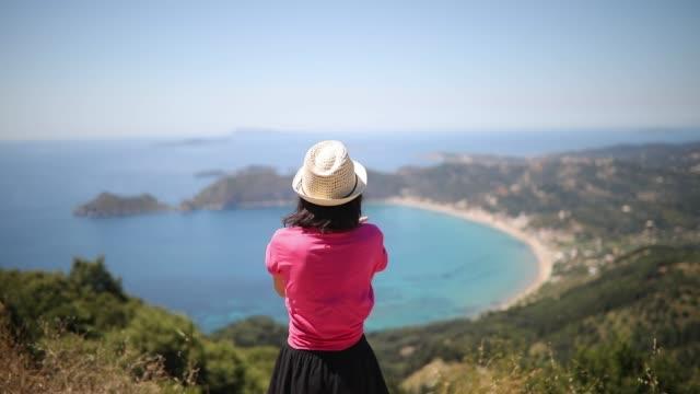 beautiful woman dancing at the corfu island - greek islands stock videos and b-roll footage