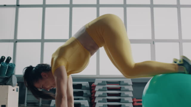 beautiful woman doing exercise with fit ball - fitness ball stock videos & royalty-free footage