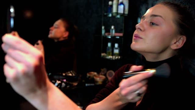beautiful woman doing her make up applying blusher - blusher stock videos & royalty-free footage