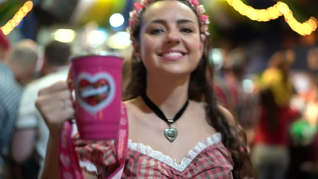 beautiful woman drinking beer at oktoberfest - month stock videos & royalty-free footage