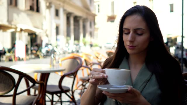 beautiful woman drinking coffee in rome - courtyard stock videos & royalty-free footage