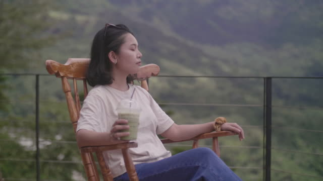 beautiful woman drinking with tea. - rocking chair stock videos & royalty-free footage