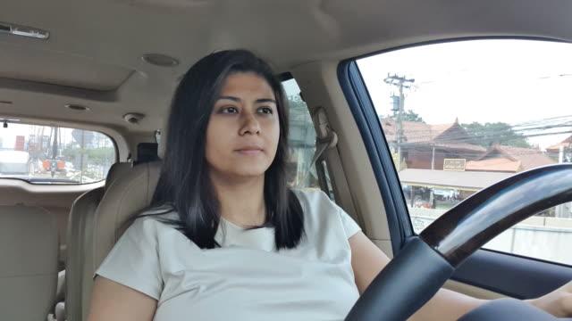 beautiful woman driving car - driveway stock videos & royalty-free footage