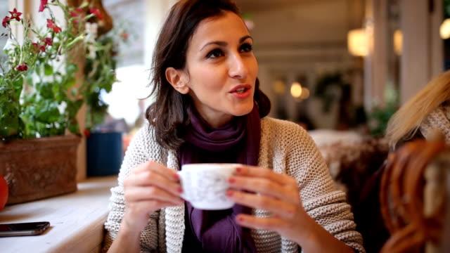 beautiful woman enjoying coffee with a friend - prague stock videos & royalty-free footage