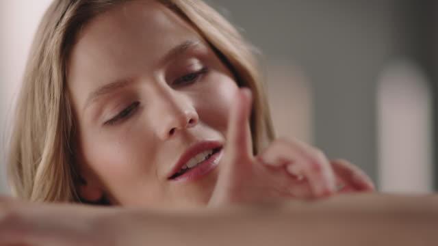 Beautiful woman enjoying her flawless skin