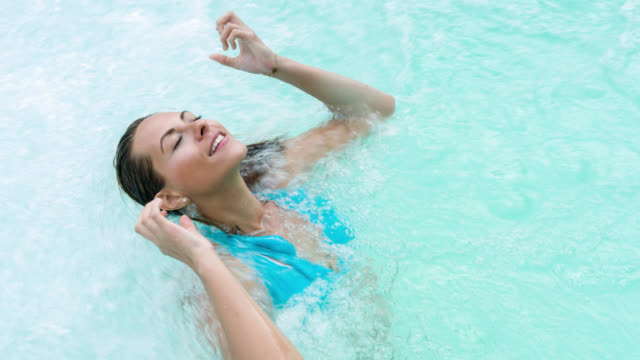 Beautiful woman enjoying the hydrotherapy at the spa