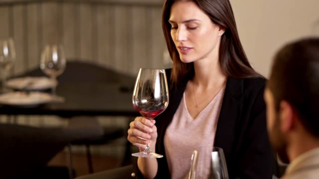 beautiful woman enjoying wine in a restaurant - serving staff stock videos & royalty-free footage
