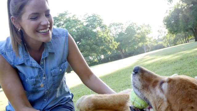 Beautiful woman enjoys spending time with her dog
