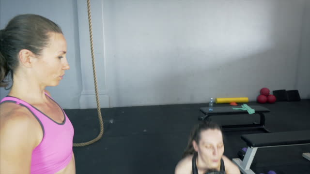 Beautiful woman exercising with personal trainer.