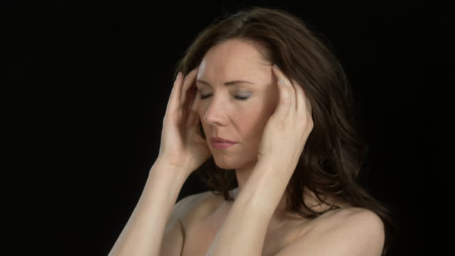 beautiful woman (45 years old) - facial expressions - headaches/megrim
