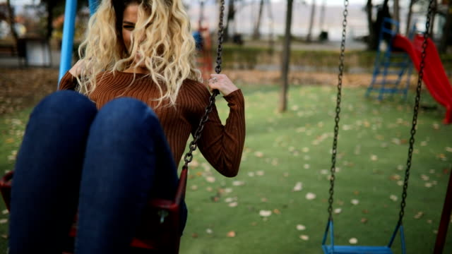 beautiful woman have fun on swing in public park - swinging stock videos & royalty-free footage