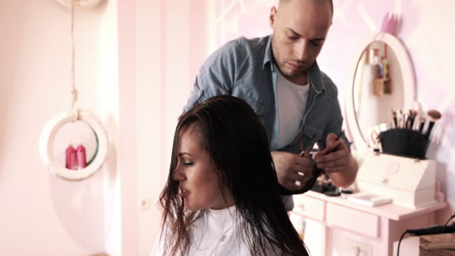 beautiful woman having a hair cut at hairdresser's. - hairstyle stock videos and b-roll footage