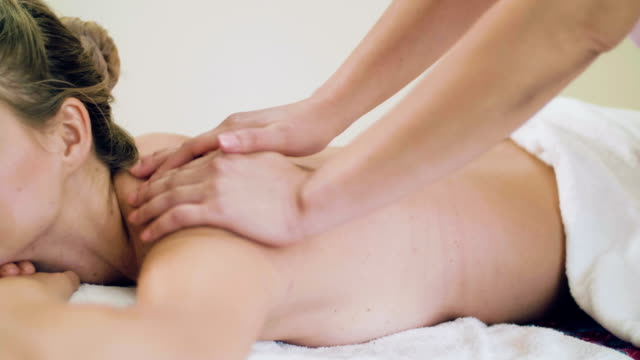 beautiful woman having back massage - health spa stock videos and b-roll footage