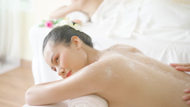 beautiful woman having exfoliation treatment in spa - exfoliation stock videos & royalty-free footage