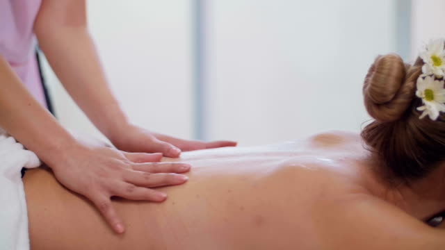 beautiful woman having relaxation in spa massage - health farm stock videos & royalty-free footage