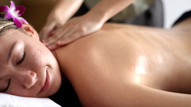 beautiful woman having relaxing in spa massage salon. - massaging stock videos & royalty-free footage