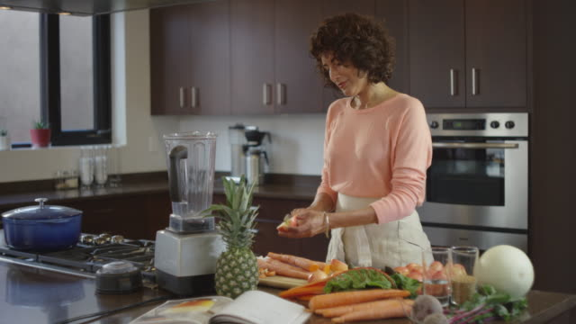 beautiful woman in kitchen using juicer - beautiful woman stock videos & royalty-free footage