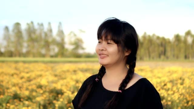 beautiful woman in nature yellow flower scene