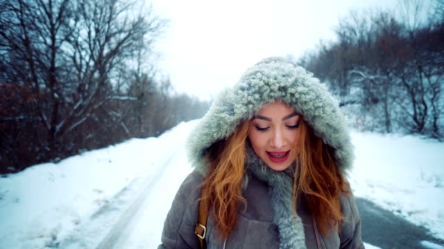 Beautiful woman in winter walk