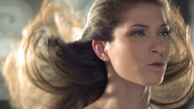 a beautiful woman is flicking her hair back. - green eyes stock videos and b-roll footage