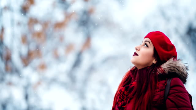 beautiful woman is watching snowing - frozen stock videos & royalty-free footage